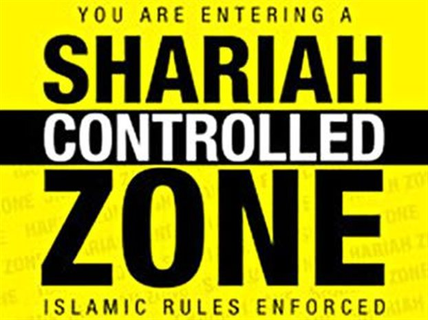 London Police establish England's first 'Sharia zone' in which EDL's Tommy Robinson is not allowed entry.