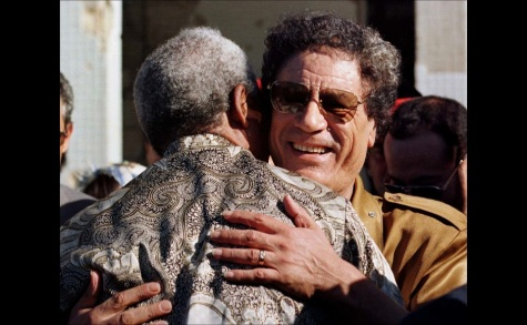 PRESIDENT NELSON MANDELA IS GREETED BY MUAMMAR GADDAFI IN TRIPOLI